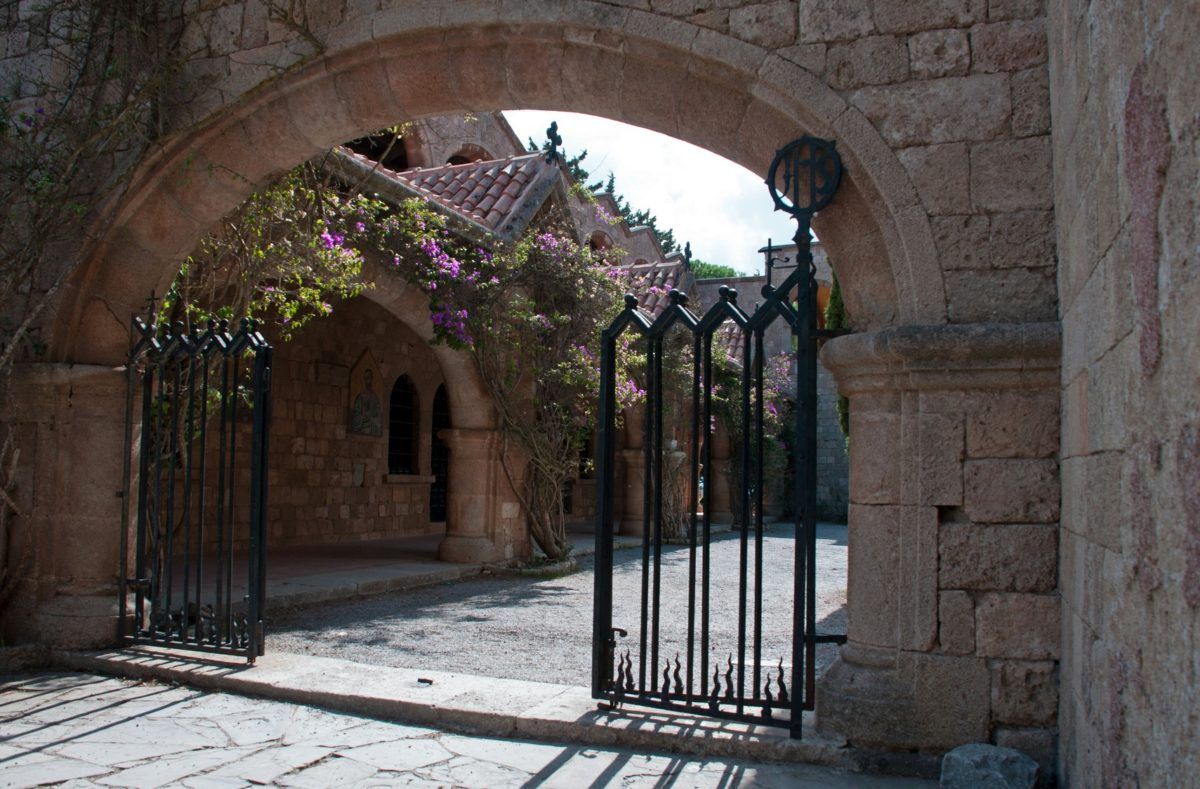 Gated entrance to the Cloisters and Medieval Frescoes at Ialyssos monastery on the Greek island of Rhodes. Built on the top of Mount Filerimos