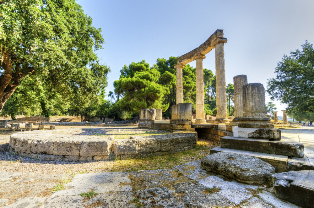 Ruins of the ancient site of Olympia, specifically the Philippeion in the Altis of Olympia, which was an Ionic circular memorial of ivory and gold. The Olympic games originate from there.