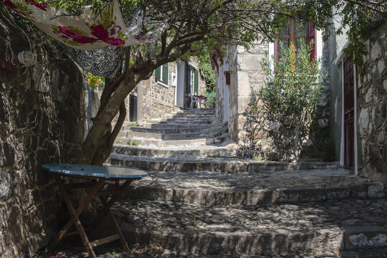 A narrow street in Molivos in Greek Island Lesbos.
