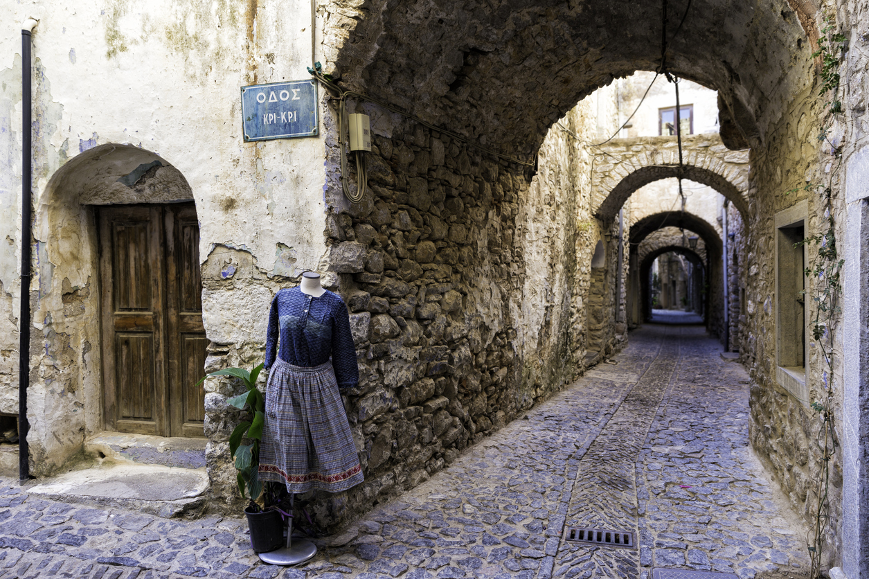 Mesta, Chios Island, Greece - July 8, 2016: Mannequins with women dress on the narrow streets of Mesta village in Chios Island, Greece. Chios, Sakiz Adasi in Turkish, is the fifth largest of the Greek islands, situated in the Aegean Sea